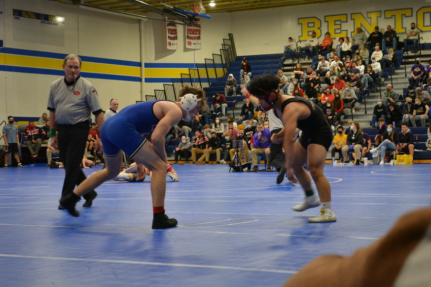 Josh Seman goes after a wrestler in action last week for the Comets.