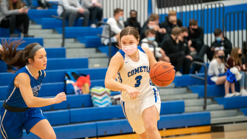 Sailor Hall moves the ball down court for the Comets.