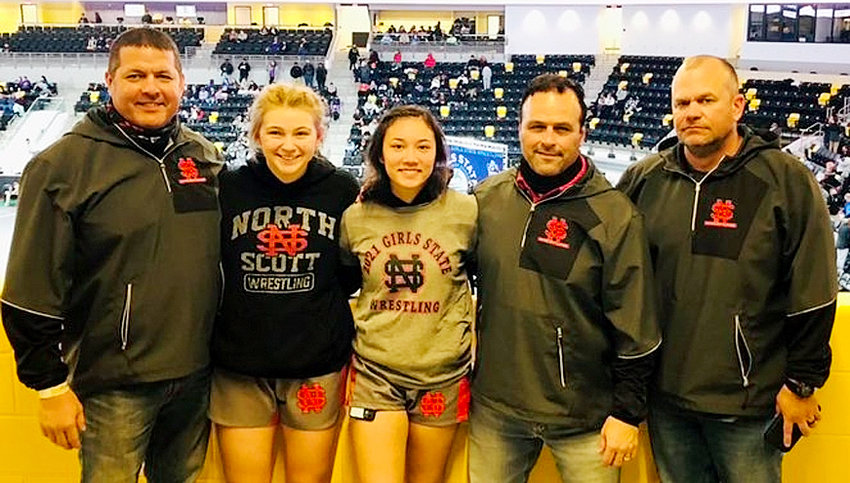 North Scott sophomores Jorie Hanenburg (l) and Khylie Wainwright both earned top 12 finishes at the Girls' State Wrestling Tournament in Coralville. They are pictured with coaches (l-r) Tony Yates, Brian Thomas and Andy Straley.