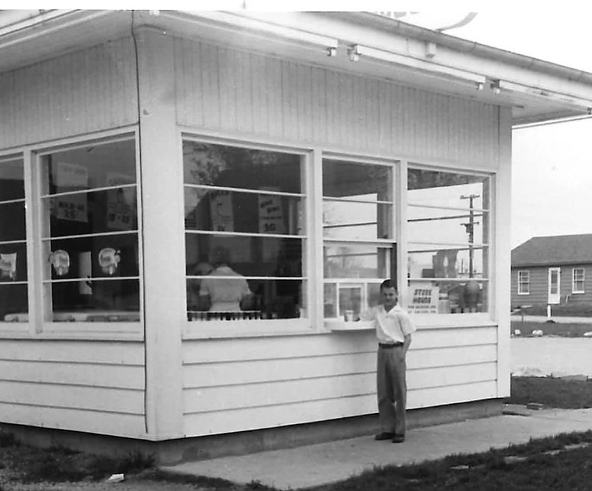 A young Jack Kirby stands in front of the former Frigid Queen ice cream shop that occupied the corner of Maxson and Columbus Streets. His parents, John and Jean Kirby, once owned the business, where a dog grooming shop now resides. Opened first in 1950, the business had a number of owners through the years - even serving sandwiches like Made-Rites at one time before the building was turned into a pizza express in 2011, followed by turning into a dog grooming center by 2014.