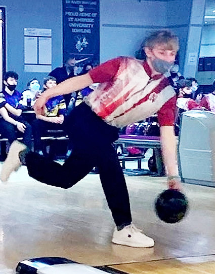 Lancer junior Jacob Ohsann rolled a high game of 221 en route to a 418 series to pace North Scott's Scarlet team to the junior varsity title at Saturday's Lancer Invitational.
