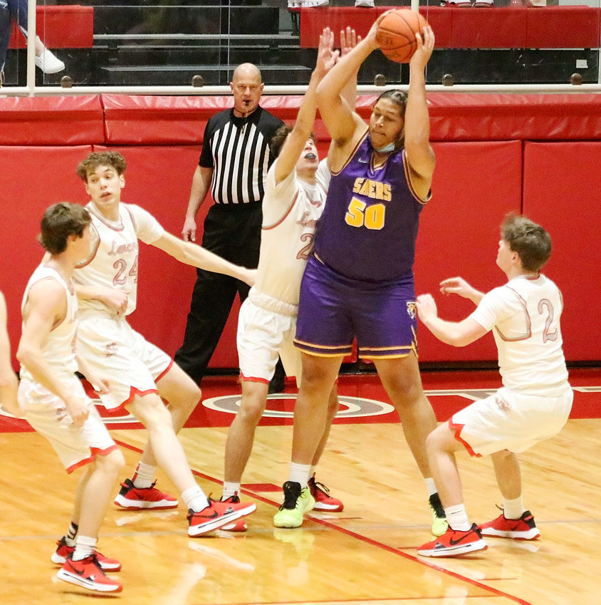 "North Scott's lack of size was on full display in last week's 42-36 loss to Central DeWitt, as (l-r) Ollie Hughes, Landon Eiland, Canon Guffey and Drew Kilburg tried to keep 6'8"" Saber Shawn Gilbert at bay."