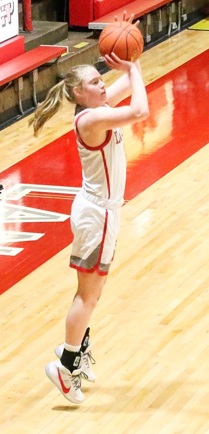 Sparked by the three-point shooting of sophomore Hattie Hagedorn (pictured) and senior Sam Scott, North Scott rolled to an early 16-0 lead in the regional semifinal win over Keokuk and never looked back.