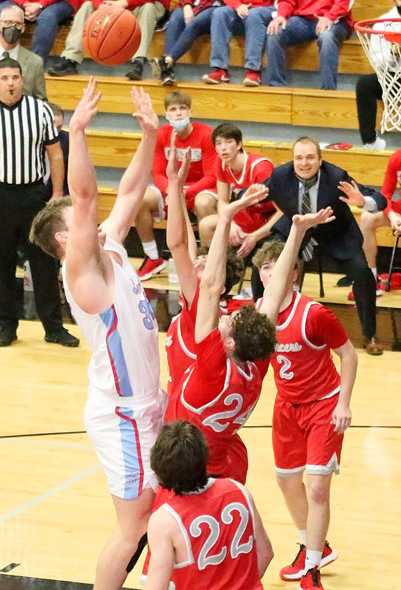 """With coach Shamus Budde coaching from the sidelines, the Lancers did their best to stop the tall and talented Dubuque Senior attack, including this shot from 6'6"""" Jim Bonifas. Picture (bottom to top) are Carter Markham, Landon Eiland, Canon Guffey and Drew Kilburg (2)."""