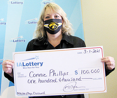 """Connie Phillips won the 20th top prize in the Iowa Lottery's """"$100,000 Mega Crossword"""" scratch game. She purchased her winning ticket at A&E Travel Center, 4701 U.S. Highway 61 in Muscatine, and claimed her prize March 1 at the lottery's Cedar Rapids regional office. The $100,000 Mega Crossword is a $10 scratch game that features overall odds of 1 in 3.29 and 25 top prizes of $100,000. For more information about this game, and the number of prizes still available, visit ialottery.com."""