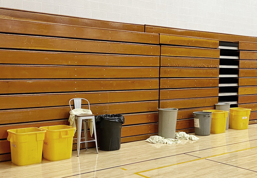 As several inches of snow began melting in recent weeks, several more roof leaks were discovered at the Durant School District, including leaking in the high school gymnasium. Several waste baskets (pictured above) have been placed around the gym when leaking occurs. The district approved a bid March 8 to repair the rest of its roofs this summer.