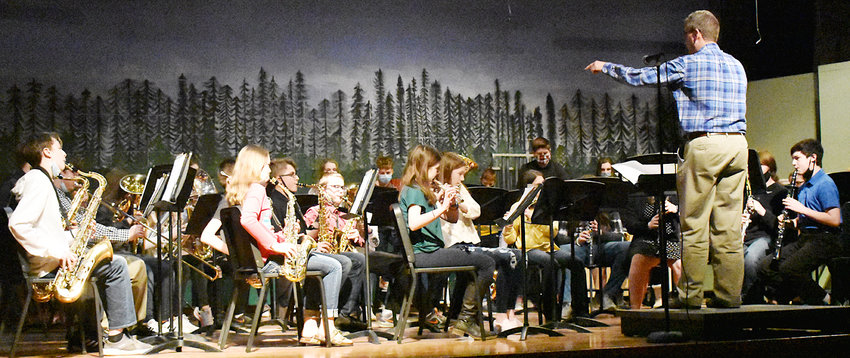 """Durant junior high band director Kevin Mundt (right) is shown directing the Durant junior high band at an in-person concert held in the Durant High School auditorium recently. The band performed """"Wonka's Theme Song"""" by Victor Lopez, """"Bohemian Rhapsody"""" by Queen, and """"The Bare Necessities"""" by Terry Gilkyson."""