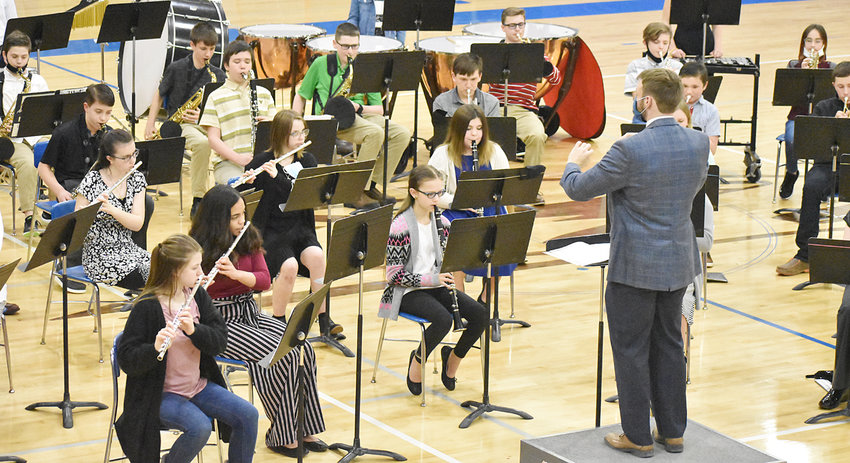 """The Wilton junior high band hosted an in-person spring concert March 16 in the high school gym. Under the direction of band director Jakson Cole (pictured), the band performed """"Drive"""" by Mark Williams, """"Meeting at Tryon Place"""" by Richard Saucedo, """"Tyrannosaurus Charlie"""" by Dean Sorenson, """"A Blues to Grow On"""" by Dean Sorenson, and """"Arabian Dances"""" by Roland Barrett. Members of the band are shown above during the live show. The next junior high band concert is May 10 at 7 p.m. in the high school gym."""