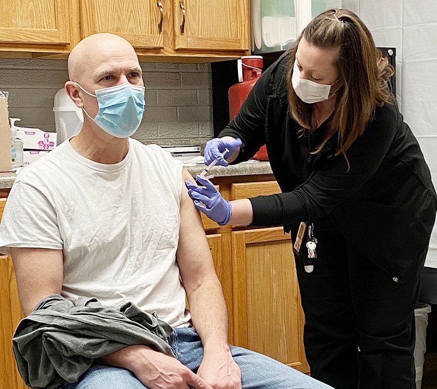 Durant Superintendent Joe Burnett receives his second COVID-19 vaccine shot from school nurse Mary Dorris.