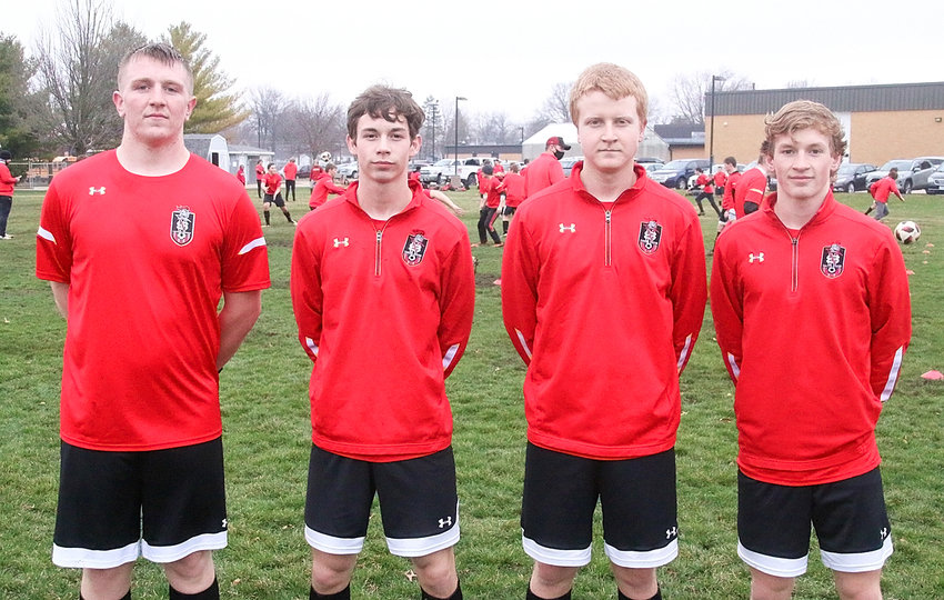 These four seniors were elected as team captains by their teammates. From left: Kade Tippet, Logan Cole, Baylor Verbrugge and Chase Porter.