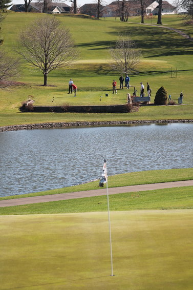 Firing shots over the lake hole at West Liberty Golf & Country Club were the West Liberty and West Branch teams in their first outing Monday.