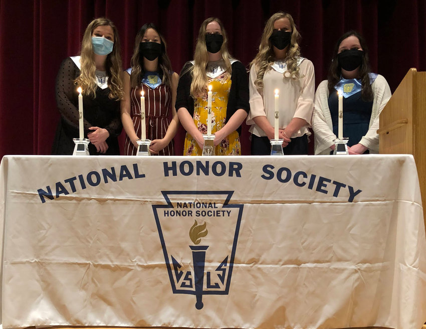West Liberty High School National Honor Society chapter officers lit special candles Tuesday, March 23, at the special induction ceremony for the organization. From left, officers participating in the ceremony include Historian Janey Gingerich lighting the Candle of Character, Secretary Abby TanChinh lighting the Candle of Scholarship, President Martha Pace lighting the NHS Central Candle, Vice president Isabel Morrison lighting the Candle of Leadership and Treasurer Allison Wickman lighting the Candle of Service.