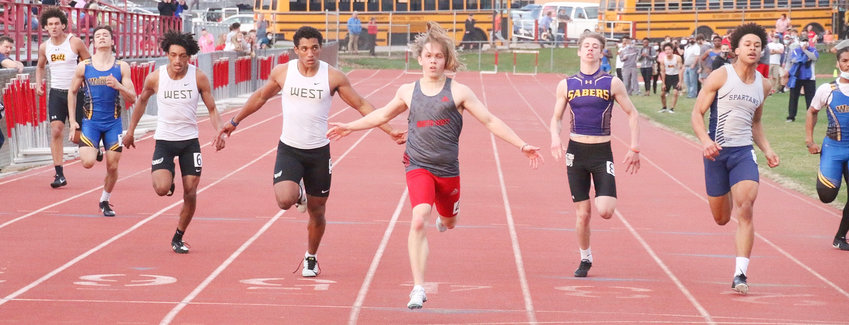 With his long hair flying behind him, Lancer junior Dane Treiber led the 200-meter field across the finish line at Tuesday's (April 6) Deac Ryan Relays. Treiber also anchored North Scott's 4x200 entry to a second-place finish.