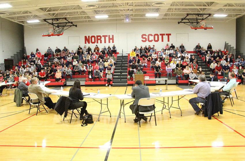North Scott school board members listen at the Monday, April 12 meeting at North Scott Junior High.