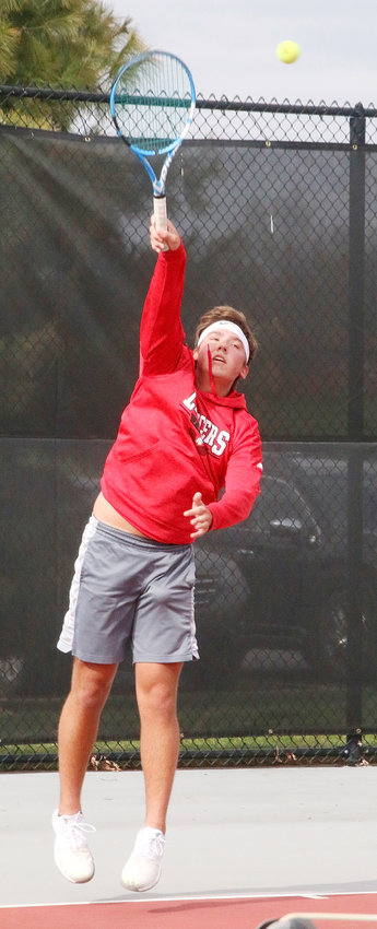 Junior Zach Johnson has established himself as North Scott's No. 1 singles player.