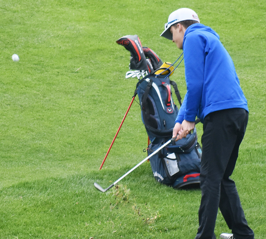 Wilton's Chase Garvin chips to the ninth green at Tipton.