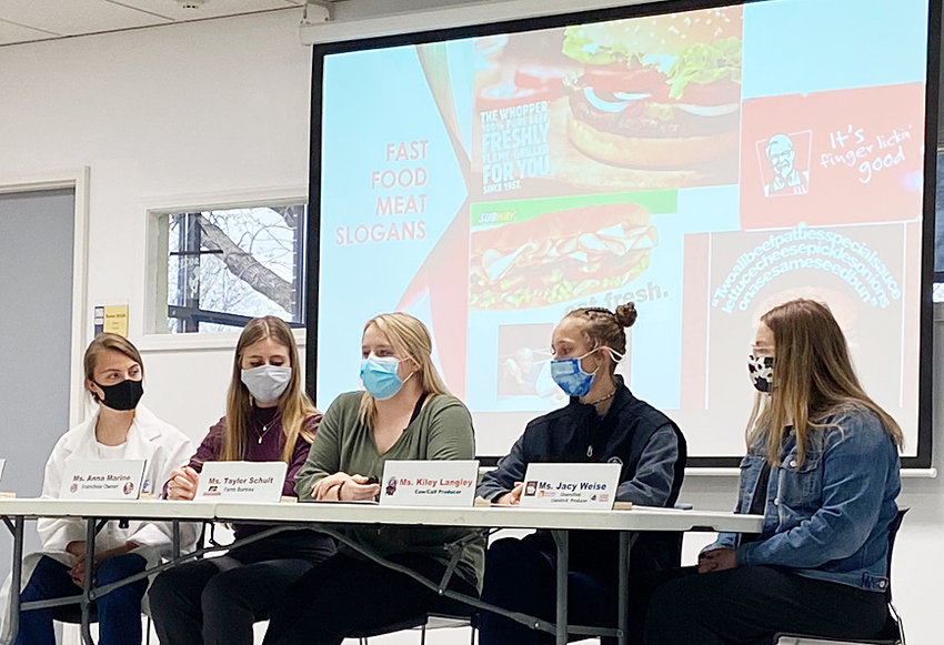 Members of the Wilton FFA Ag Issues Team held a mock debate about meat vs. veggie burgers at the Wilton school board meeting April 14. Students participating included (from left) Elizabeth Daufeldt, Anna Marine, Taylor Schult, Kiley Langley and Jacy Weise.