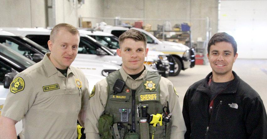 From left: Bradley Rubino, Ed Mauro and Carlos Delgado at an April 22 ceremony at the sheriff's patrol station in Eldridge.