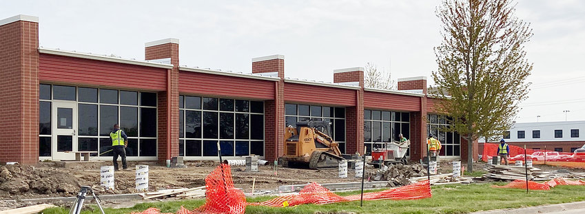 A crew from All American Concrete in West Liberty is shown working at the site of the outdoor Reading Garden coming to the Wilton Public Library.