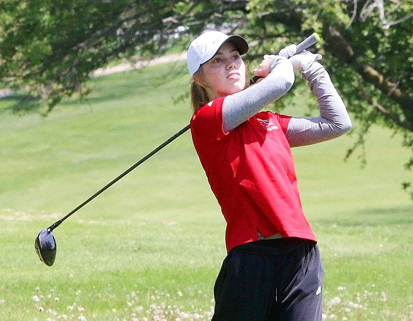 Lancer sophomore Elle Loehr stares down her drive on the seventh hole at Monday's Mississippi Athletic Conference tournament at Kewanee Dunes. Loehr carded a 98, which was good for a seventh-place finish.
