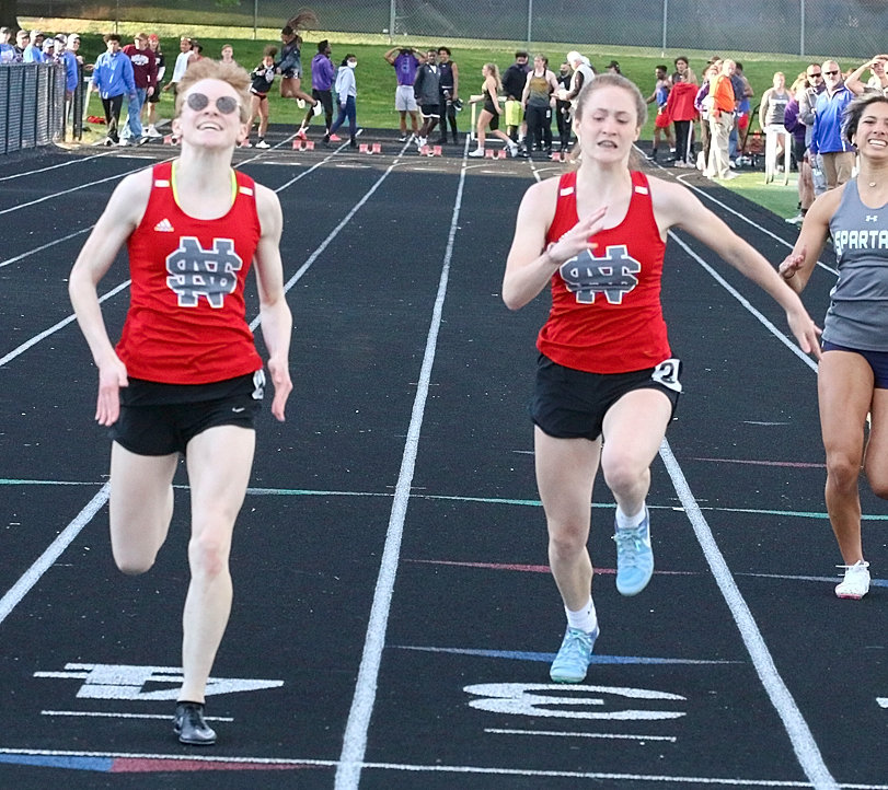 NS junior Athena Nelson (l) and freshman Mercie Hansel finished one-two in the 100 meter dash at Thursday's district meet. Nelson will compete in four events at this week's state meet, while Hansel will run in three.