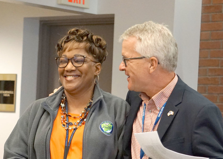 2019: Scott County supervisor Tony Knobbe congratulates Roma Taylor on her 40th anniversary in 2019, when she announced her imminent retirement, postponed twice since then.