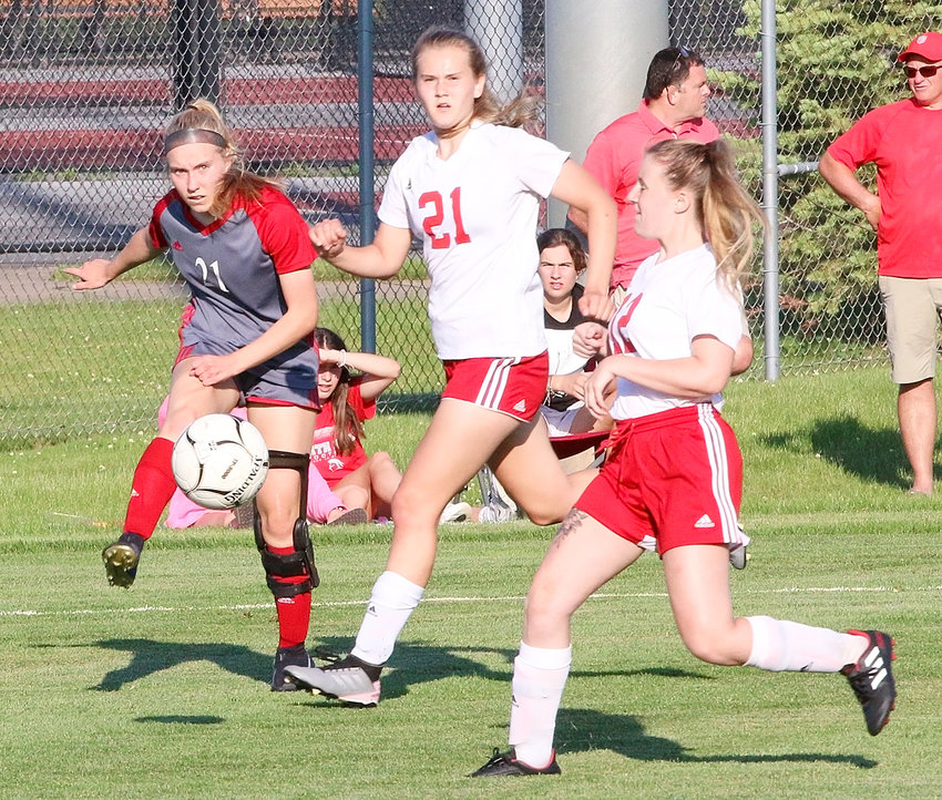 Freshman Bailie Arbogast fires a cross pass in the semifinal victory over Fort Madison.