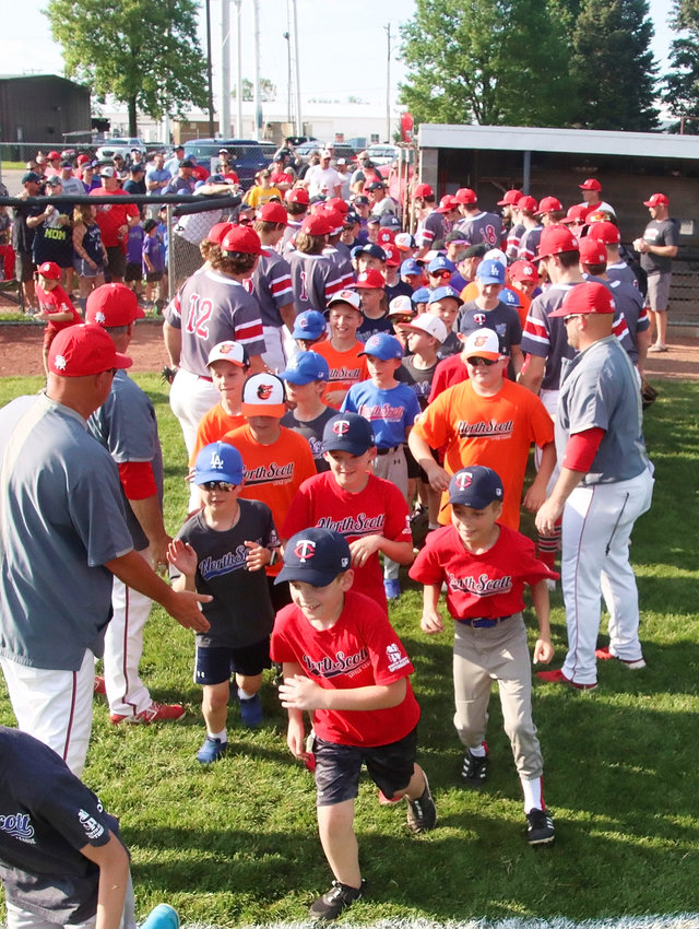 Little Leaguers were greeted by North Scott players and coaches as they took the field prior to the June 2 game with Cedar Rapids Washington.