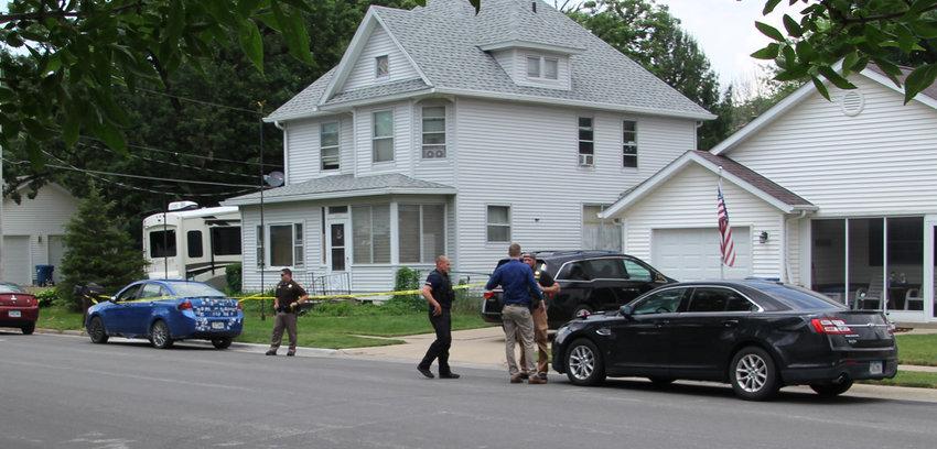 Eldridge interim police chief Joe Sisler, center, at the June 10 homicide scene with Scott County sheriff and Iowa State Patrol officers.