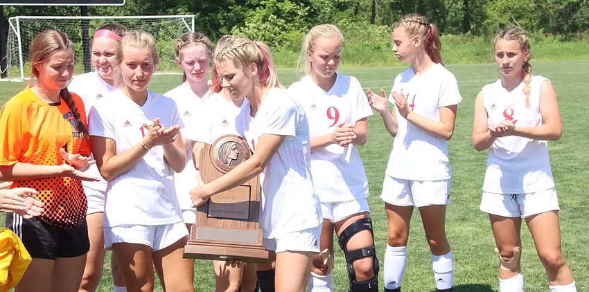 Faces told the story after North Scott received its state tournament trophy following the quarterfinal loss to Norwalk. From left: Natalie Knepper, Mackenzie Bohr, Reagan Schoening, Brooklyn Bullock, Faith Rains and Adeline Finnicum.