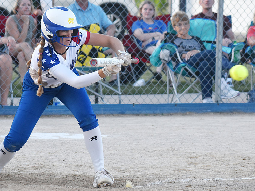 Durant leadoff hitter Ally Happ squares up to bunt in a home game against North Cedar on military appreciation night June 8. The Cats downed the Knights 10-5 in five innings.
