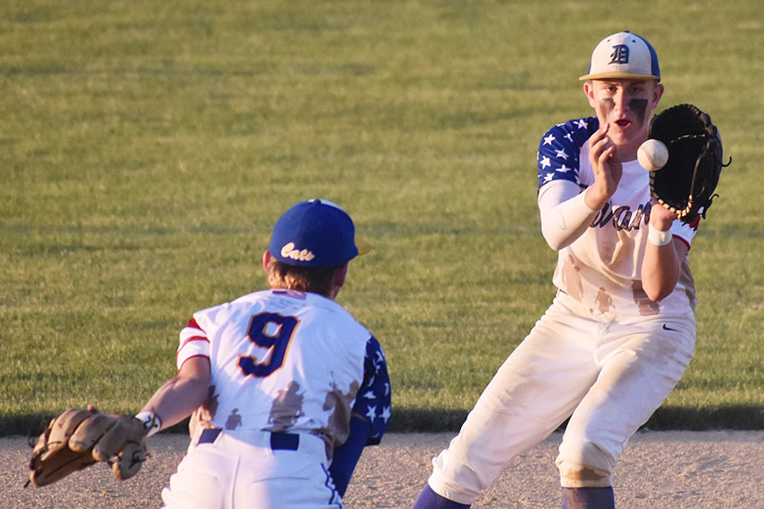 Durant second baseman Koby Paulsen (right) accepts a toss from shortstop Ethan Gast in home action against North Cedar on military appreciation night June 8. The duo helped turn a double play in the Wildcats' 11-1 win over the Knights.