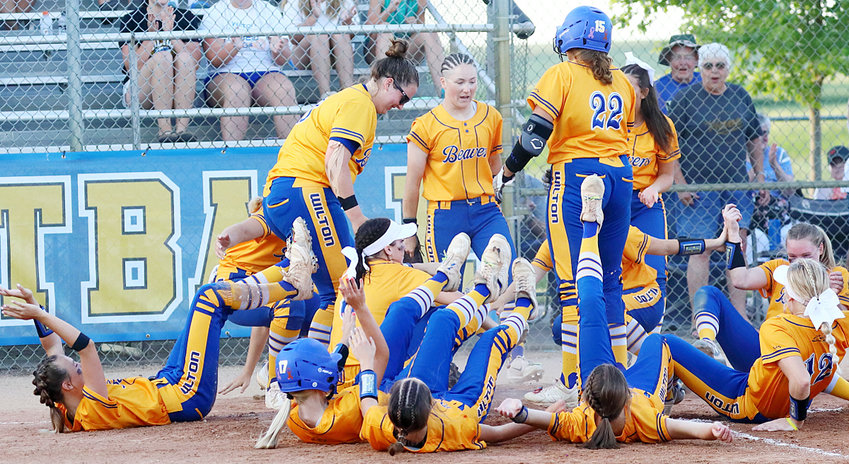 Wilton teammates demonstrates an interesting celebration after a Hayley Madlock (No. 22) home run in an 8-7 home win over Northeast June 8.