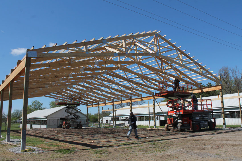 Workmen quickly put up the new second show ring at the Muscatine County Fairgrounds in 2020, to be named the Dahfeldt Family Show Ring. The building will get its first use this year at the fair.