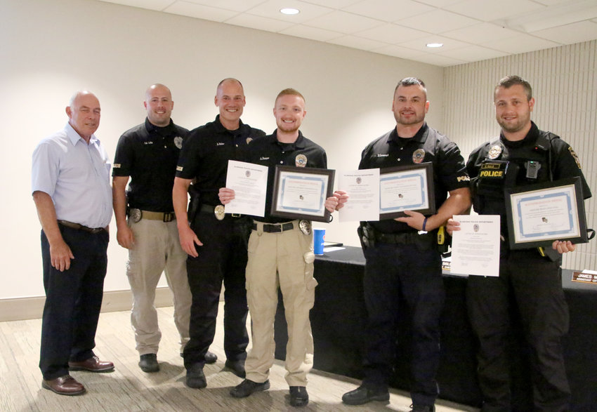 Mayor Marty O'Boyle, Sgt. Andrew Lellig, interim chief Joe Sisler, officers Andrew DeNoyer, Tony Cavanaugh and Ryan Gale.