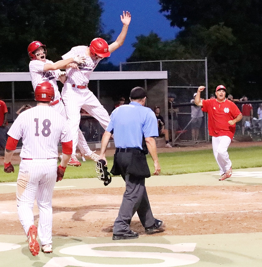 North Scott seniors Dylan Elam (l) and Alex Johnson celebrate after Johnson scored the winning run in Monday's 2-1 substate semifinal win over Davenport West.