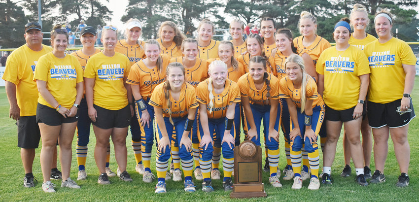 Beavers fourth in Class 2A—The Wilton softball team finished the Class 2A state softball tournament in fourth place last week. The Beavers went 1-2 in action at Fort Dodge July 19-22. Wilton lost 9-6 in the 2A semifinals to Earlham, before losing 12-1 to Central Springs in the third place game. See pages 9-13 for state coverage. The fourth place finish was the highest softball finish in school history. Wilton finished the season ranked No. 1, and was the top seed in the state tournament. Team members include (front from left) Emi Coss, Tessa Bartell, Maddy Wade, Lexi Walker; second row, assistant coach Allison Bosten, head coach Kortney Denkman, Peyton Souhrada, Catie Hook, Taylor Drayfahl, Kaylee Coss, Ansley Boorn, assistant coaches Kelly Jo Jannings and Kara Anderson; back row, assistant coach Tom Austin, Chloe Wells, Payton Ganzer, Hayley Madlock, Mila Johnson, Charlotte Brown, Joann Martin, Grace Madlock, assistant coach Kamryn Meyer.