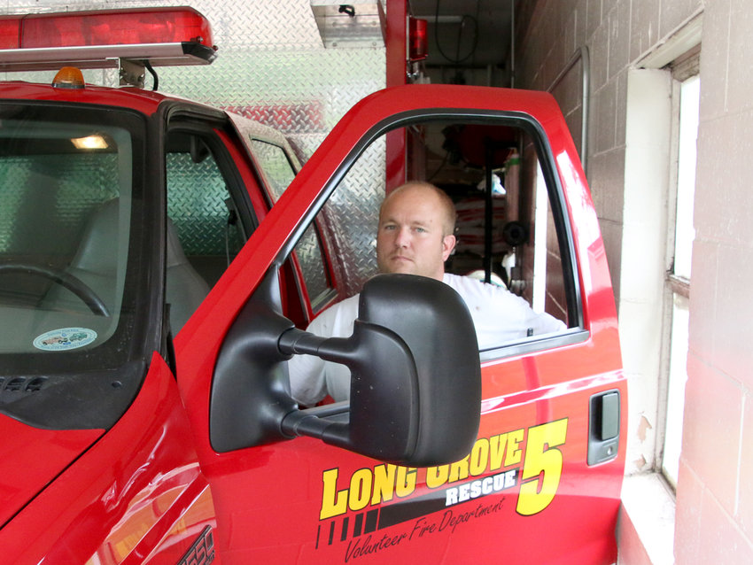 Long Grove fire chief Josh Roe says firefighters in full gear can barely fit between trucks in the current fire station.