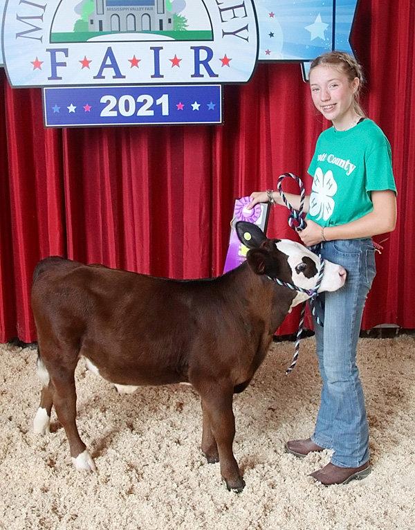 Emmalynn Golinghorst showed the Champion Intermediate Bucket Calf.