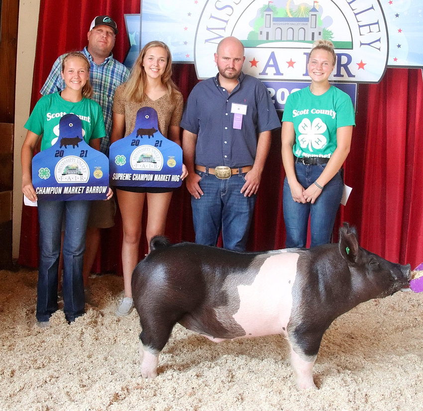 Makenna Buesing showed the Supreme Overall Market Hog with this Champion Market Barrow that weighed in at 270 pounds. Makenna is pictured with judge Hayden Wirth, her dad, Randy, and sisters Rilynn and Peyton.