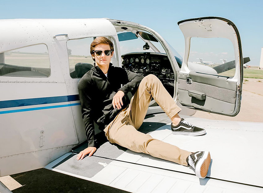 Wilton senior Gage Oien is shown above, posing for one of his senior pictures with one of the planes he's been using for flying lessons. Oien has aspirations of becoming a commercial pilot
