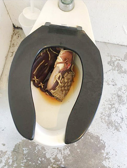 Vandalism in Wilton parks—Pictures were submitted to members of the Wilton city council Aug. 23, depicting vandalism occurring in bathrooms at Cherrydale Park in Wilton's south end. A baseball glove was placed in a toilet (left) and items were stuffed in the drain of a sink (right). The bathrooms were temporarily closed, but have reopened with surveillance outside the restrooms.