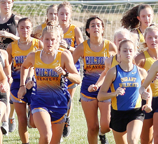 The Wilton girls team and Durant's Carlie Jo Fusco are shown taking off from the starting line in Tipton.