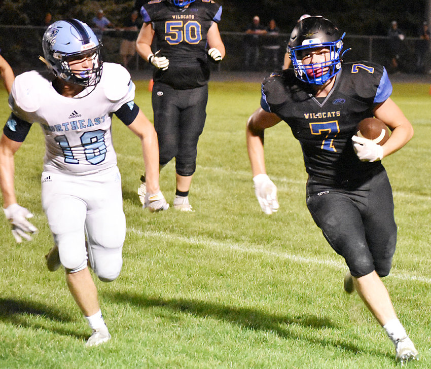 Durant's Carter Wichelt (right) looks to take the ball to the sideline after making a catch in home action against Northeast Sept. 10. The Wildcats lost their homecoming bid 42-28 to the visiting Rebels.