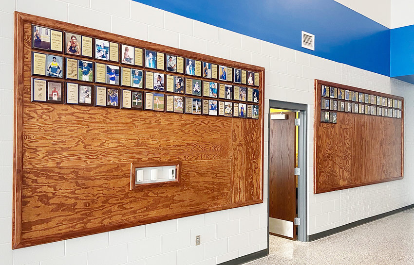 New boards were recently installed in the Townsend Commons at Wilton High School, to display All-State plaques of former Wilton Beaver student-athletes. The boards are located outside the home side entrance on the wall to the concession stand, and allow for plenty more to be added over the years.