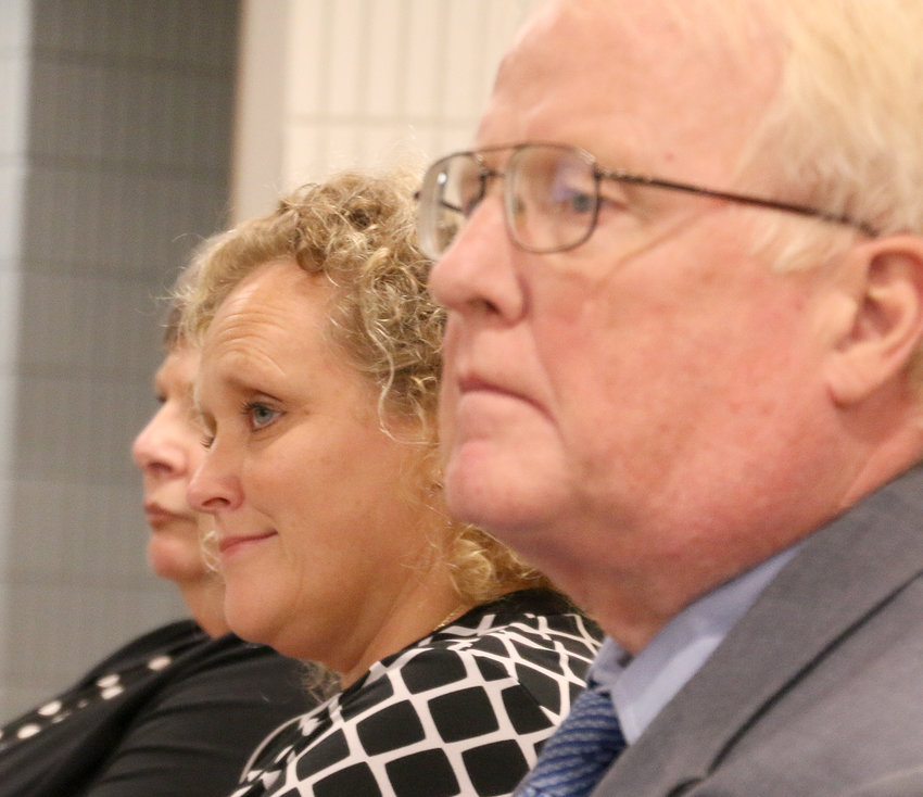 Eldridge city administrator Lisa Kotter returned to council chambers for the first time in seven weeks. She is seated between her attorney, Mike Meloy, and resident Sue Cheek.