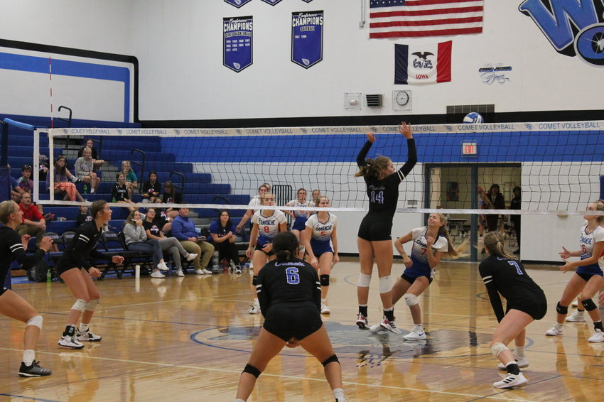 Maelyn Wainwright goes high to blcok a shot of a Cammanche player in Thursday's game, the 16th straight win for the Comets this season.
