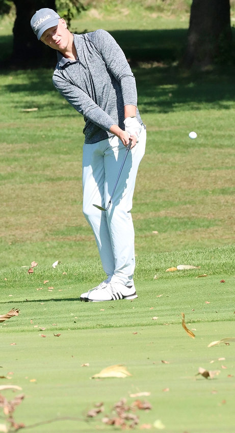 North Scott junior John Dobbe battled wind and flying corn husks to card an 81 on Friday. Dobbe finished seventh overall.