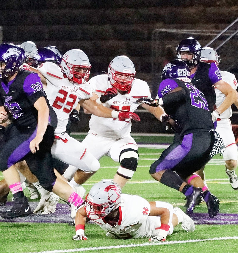Lancer senior Ryan Campbell (23) and junior David Borchers are zeroed in to stop Grayhound running back Bryant Williams on this play.