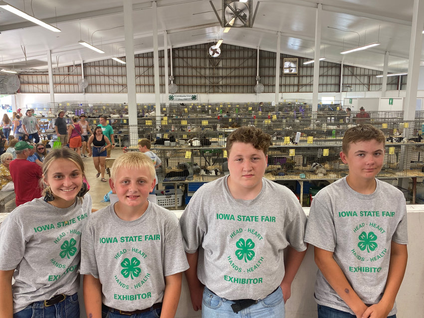 Scott County 4-Her's (l-r) Abigaile Paper, Colin Engelbrecht, Joey Porter and Cole Engelbrecht pose for a picture at the 4-H Rabbit Show at the Iowa State Fair.